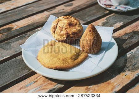 Traditional Portuguese And Brazilian Snacks On A Plate: Coxinha, Empada De Galinha, And Rissole