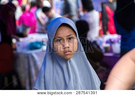 Tuaran, Sabah, Malaysia-january 25,2018: Street Photo View Of Portraiture Malaysian Muslim Young Lad