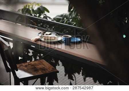 Abstract Scene Of Breakfast Meal Set Including Tuna Sandwich, Hot Long Black Coffee, And Brownie Che