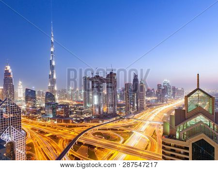 DUBAI, UAE - FEBRUARY 16: Burj Khalifa the tallest building in the world. Dubai Downtown cityscape. Dubai evening skyline, busy Sheikh Zayed road intersection, sunset on February 16, 2018 in Dubai