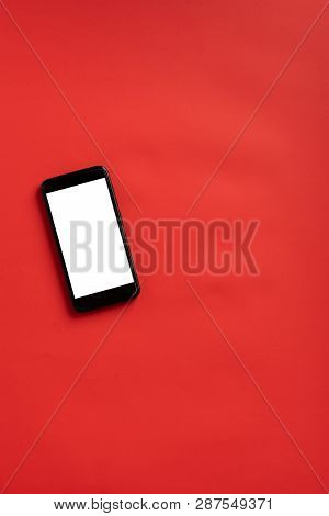 Smart Phone With Blank Screen On Red Background. Wireless Communication Concept In Abstract Scene.