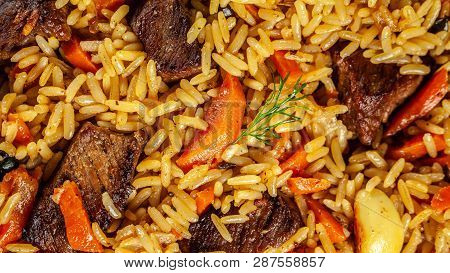 The Concept Of Oriental Cuisine. Texture Of Uzbek Pilaf With Meat, Vegan Pilaf. Top View, Copy Space