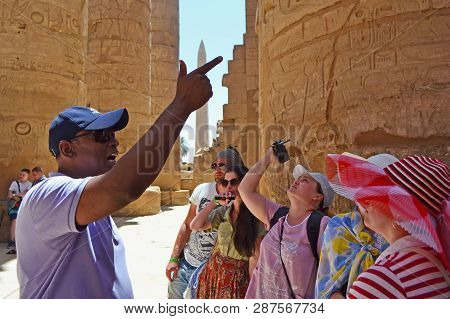 Karnak, Egypt - 17th May, 2018: A Group Of Adult Caucasian Tourists Visiting The Interior Of The Tem