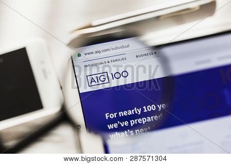 New York, Usa - 6 March 2019: American International Group, Aig Official Website Homepage Under Magn