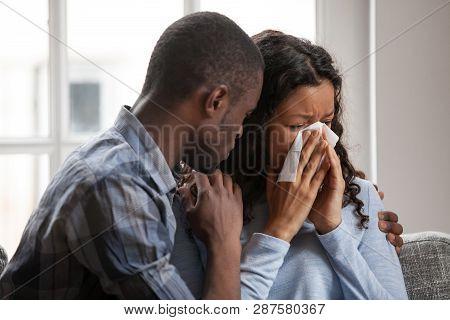 Caring Black Husband Hug Supporting Sad Crying Wife