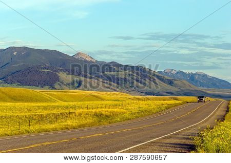 Local Road Through The Meadows Of Sunny Montana Landscape, Usa