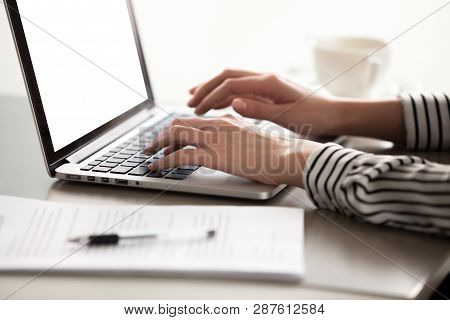 Close Up View Of Female Hands Typing On Laptop Keyboard