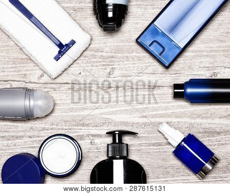 Cosmetics For Men Flat Lay Frame. Various Male Grooming Cosmetic Products On Shabby Whitewashed Wood
