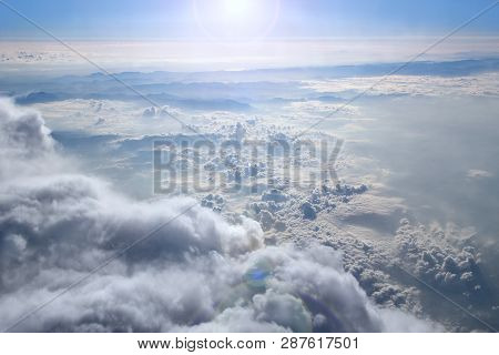 Heavenly Landscape With Shining Sun. Big White Clouds On Blue Sky. Beautiful White Clouds On Blue Sk