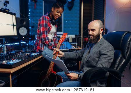 Male and female musicians, sound recording studio