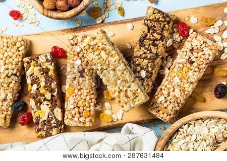 Granola Bar. Healthy  Snack. Cereal Granola Bar With Nuts, Fruits And Berries On A Blue Background.