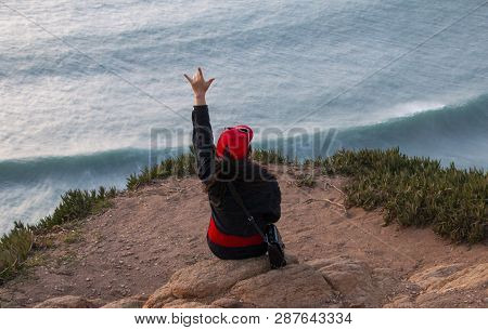 Woman Sits On The Edge Of The Earth, Cliff Edge Of Europe