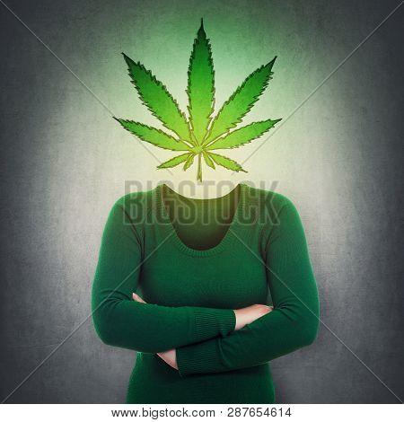 Surreal Portrait Anonymous Woman With Marijuana Leaf Symbol Instead Head Over Grey Wall. Cannabis Le