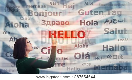 Woman Student Wearing Glasses Pointing Index Finger Up Choosing Word Hello With Different Translatio