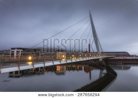 Editorial Swansea, Uk - February 16, 2019: An Early Morning Misty View Of The Millennium Bridge On T