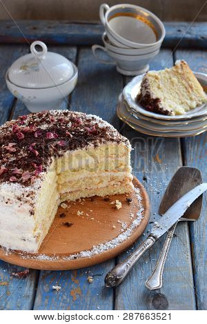 Delicious Coconut Layer Cake - Biscuit And Cream On Coconut Cream, Decorated With Grated Chocolate A