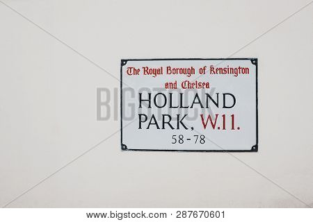 London, Uk - February 23, 2019: Holland Park Street Name Sign On A White Wall In The Royal Borough O