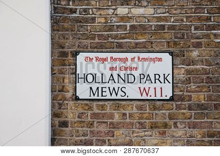 London, Uk - February 23, 2019: Holland Park Mews Street Name Sign On A Wall In The Royal Borough Of