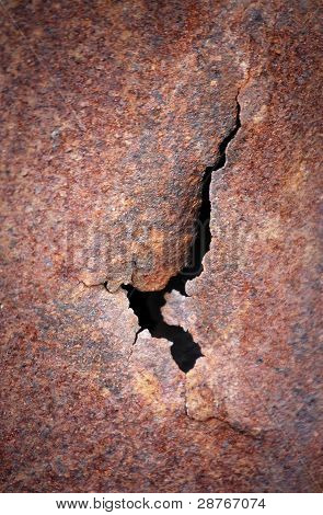 Crack At Rusty Metal Plate