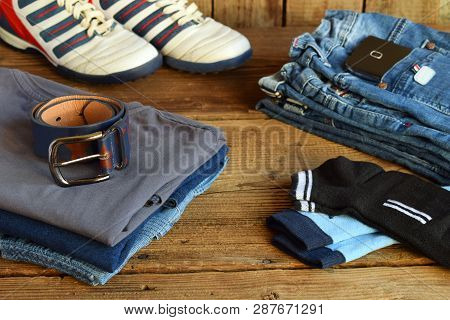 Teenager Casual Outfit. Boys Shoes, Clothing And Accessories On Wooden Background - Sweater, Shirt,