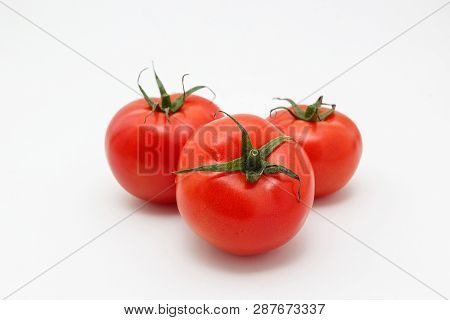 Bunch Of Ripe Tomatoes Isolated On White Background. Three Whole Vegetables With Sepals