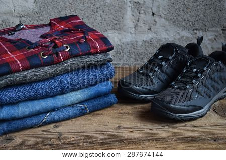Men Casual Outfit. Men's Shoes, Clothing And Accessories On Wooden Background - Sweater, Jeans, Snea