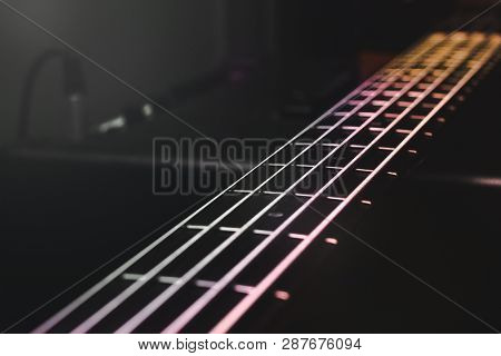 Close-up View On Bass Guitar Strings And Frets