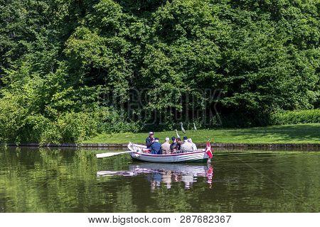 Frederiksberg, Denmark - June 17, 2017: Group Of People In A Rowboat In Frederiksberg Park. Frederik