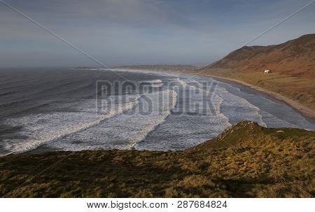 Editorial Swansea, Uk - February 17, 2019: Rhossili Bay On The Gower Peninsula, Swansea, One Of The
