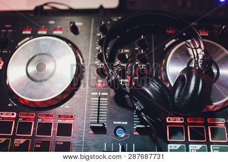 Music Console And Headphones For Dj. Dj Console Cd Mp4 Deejay Mixing Desk Music Party In Nightclub.