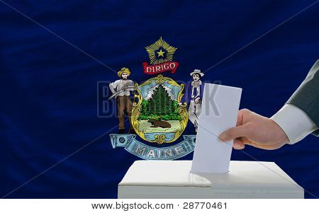 Man Voting On Elections In Front Of Flag Us State Flag Of Maine