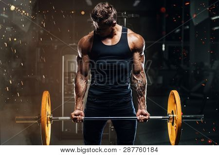 poster of Handsome strong athletic fitness men pumping up arm muscles workout barbell curl fitness concept background - muscular bodybuilder men doing bodybuilding biceps exercises in gym naked torso