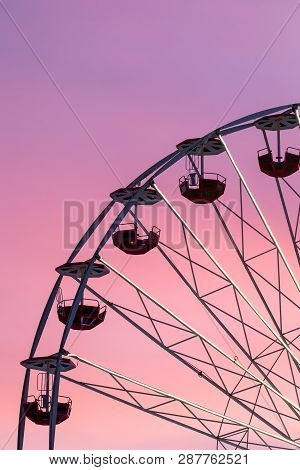 Ferris Wheel At The Pink Colorful Sunset