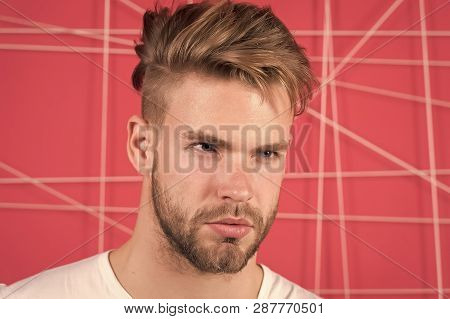 Man With Bristle On Strict Concentrated Face, Pink Background. Masculinity Concept. Guy Bearded And