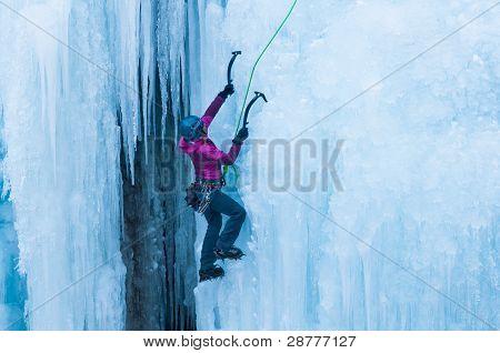 Woman climbing Ice