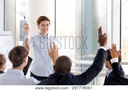 Diverse Businesspeople Raise Their Hands Voting Express Opinion Unanimously