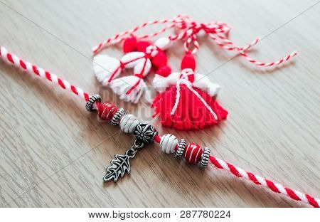 Bulgarian Traditional Spring Decor Martenitsa Bracelets, Wooden Background. Baba Marta Holiday, Back