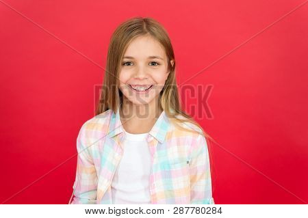Girl Joyful Smiling Face Over Red Background. Emotional Kid Happy Smiling Face. Cheerful Adorable Gi
