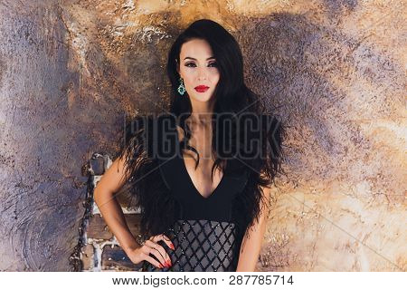 Portrait of a beautiful brunette girl boobs. poster