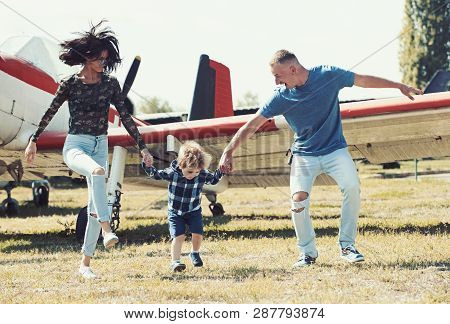 Lets Start Our Journey. Travelling By Air. Family On Vacation Trip. Couple With Boy Child At Plane.
