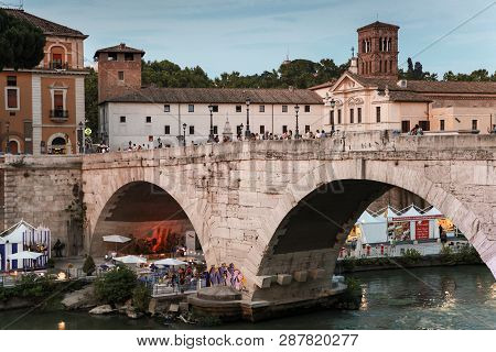 Rome, Italy - August 8, 2015: Street View With Ordinary People Walk On Pons Cestius, A Roman Stone B