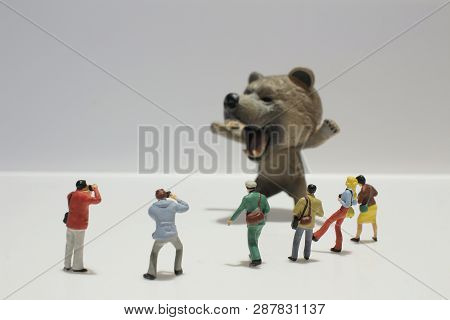 Miniature Tourists Taking Animal Picture