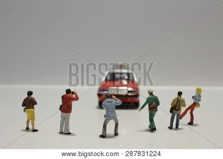 A Group Of Photographer Taking Car