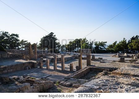 Columns Of Doric Temple In City Of Kamiros.hellenistic Houses In Ancient City Of Kamiros , Island Of