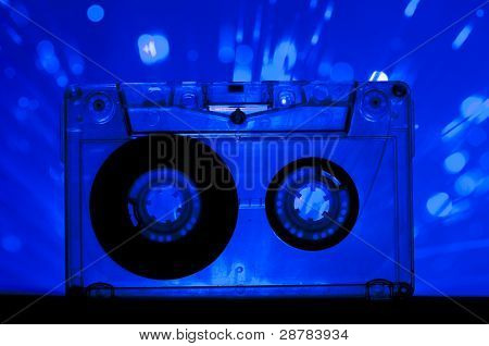 Transparent Cassette Tape And Disco Light Background