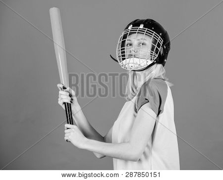 Baseball female player concept. Break sport stereotype. Woman enjoy play baseball game. Girl confident pretty blonde wear baseball helmet and hold bat on blue background. Woman in baseball sport poster