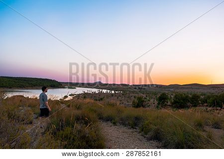 View Of Swamp In Almansa, Castilla La-mancha, Spain. Can See A Fantastic Sunset In The Image.