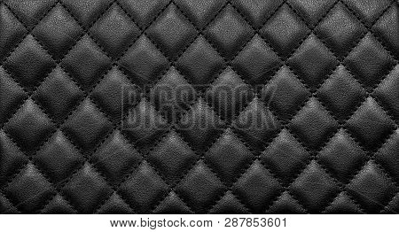 Close-up texture of genuine leather with black rhombic stitching. Luxury background poster