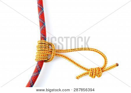 Prusik Knot Or Triple Sliding Hitch Formed With A 5mm Yellow Prusik Loop Around A 9.8mm Red Climbing