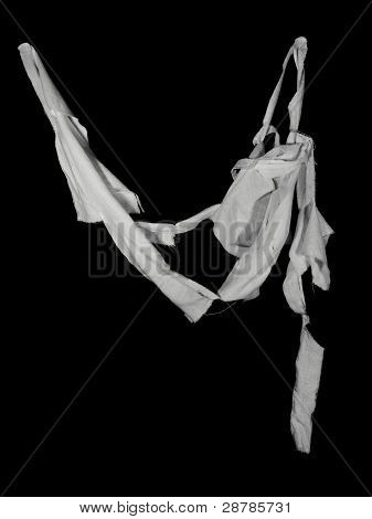 torn and ripped fabric on black background poster